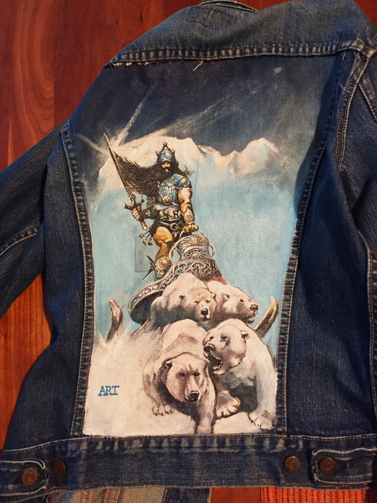 Painted denim jacket from high school. Fantasy artist Frank Frazetta acrylic painting. Note the iron-on patch near the center. A quick go to repair for rips and tears on second-hand attire.